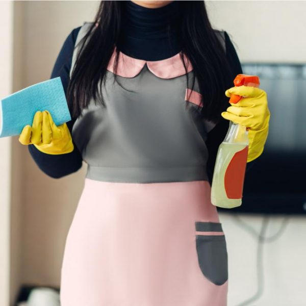 female-cleaner-holds-cleaning-equipment-in-hands-WRCTQYN