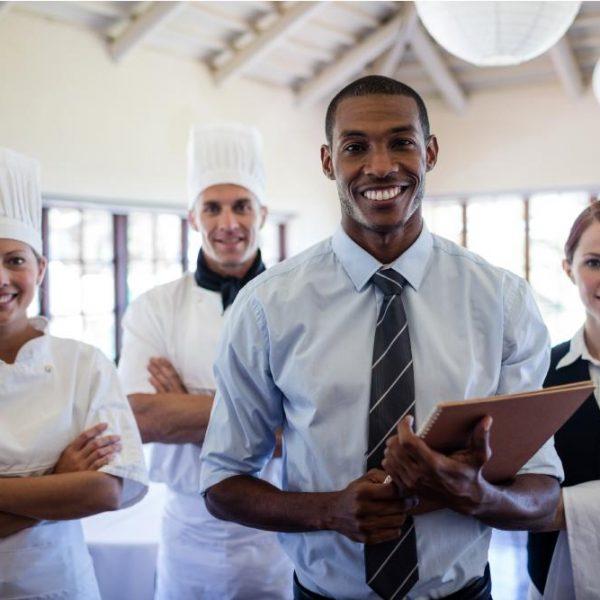 group-of-happy-hotel-staffs-standing-in-hotel-VTH4RKU